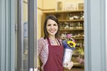 Florist opening shop door
